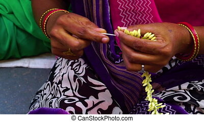 Indian floral braid - A close up shot of an Indian woman's...