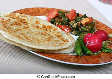 Indian food series - breads (rotis), okra (bhindi) and...