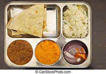 Indian food vegetarian dish of lentil dal, rice, butter tofu...
