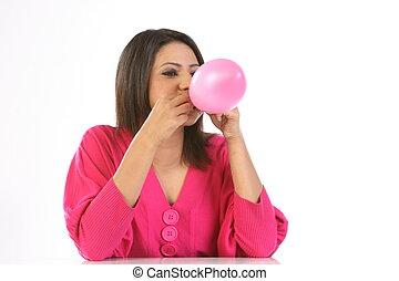 Indian girl blowing balloon