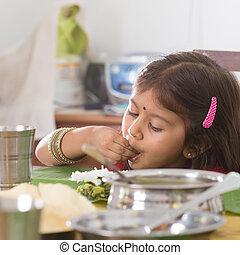 Indian girl eating rice