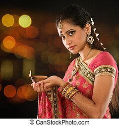 Indian girl hands holding diya lights - Indian girl in...