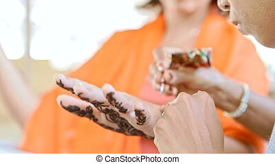 Indian Girl Master Applies Henna Tattoo on Palm