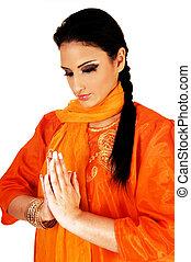 Indian girl praying.