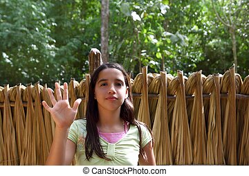 Indian girl waving greeting in jungle south american