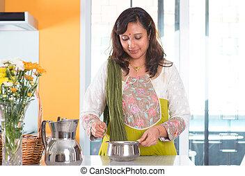 Indian housewife preparing food