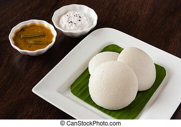 Indian idly with chutney and sambar