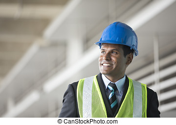 Indian industrial engineer at work. - Portrait of a male...