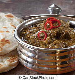 Indian Lamb Korma - Indian lamb korma curry in traditional...