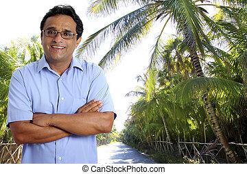 Indian latin tourist man in tropical palm tree caribbean