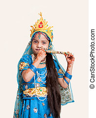 Indian little girl with flute