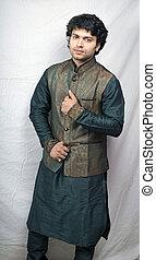 indian male model in artistic green kurta holding jacket