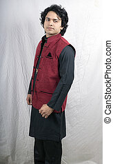 indian male model in black kurta and red half jacket side...