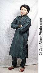 indian male model in green kurta posing calm - indian male...
