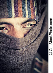 Indian man covered face by woolen s