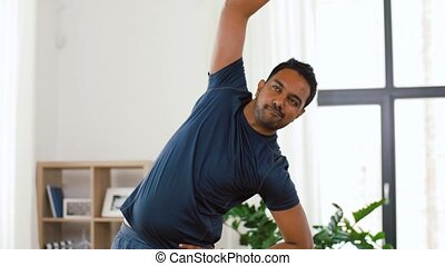 indian man exercising and leaning at home - fitness, sport...