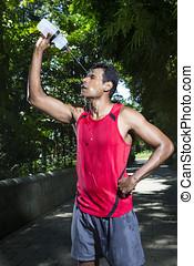 Indian man having a break from running