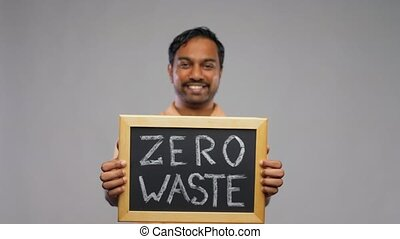 indian man holding chalkboard with zero waste - eco living, ...