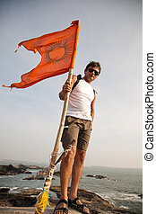 Indian man holding hindu flag