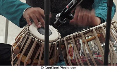 Indian man playing on Tabla - Indian man playing Indian...