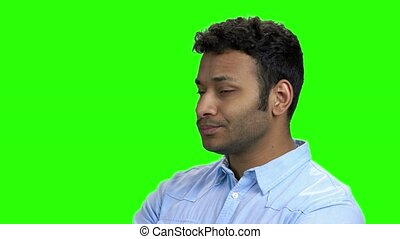 Indian man with distrust face expression. Doubtful young man...