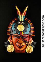 Indian Mayan Aztec ceramic mask isolated on black