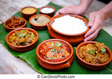 Indian meal with braised pork, curry and plain rice on...