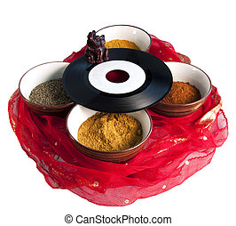 Indian music - An old 45 rpm record on four cups full of ...