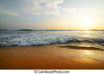 Indian ocean at sunset - Wavy clouds over Indian ocean at...