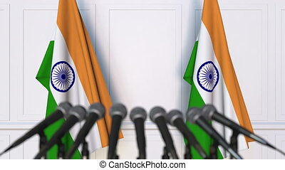 Indian official press conference. Flags of India and...