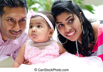 Indian parents and baby girl
