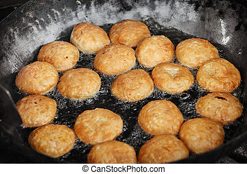 Indian pastries in a pan on the open market