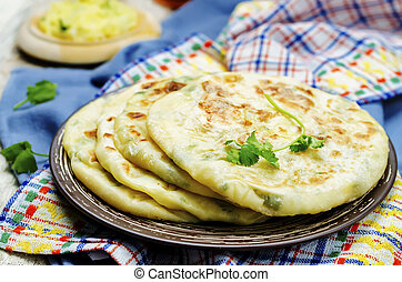 Indian Potato stuffed Flatbread. Aloo Paratha. toning....