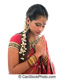 Indian prayer isolated - Portrait of beautiful young Indian...