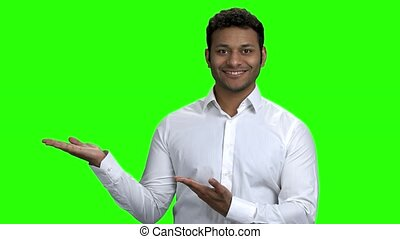 Indian promoter presenting something on green screen. Copy...
