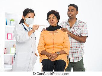 indian punjabi senior medical checkup with an asian female doctor