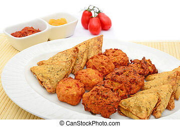 Indian snack selection and tomatoes