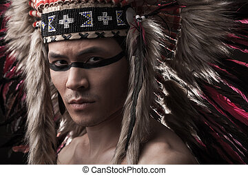 Indian strong man with traditional native american make up -...