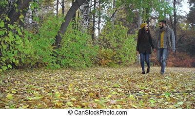Indian Summer - Low angle of romantic couple strolling along...