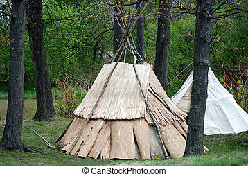 Indian teepee in woods