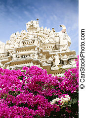 Indian temple entrance and bougainvillea flowers