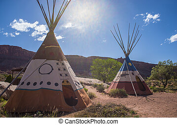Two indian Teepees against beutiful blue sunny sky