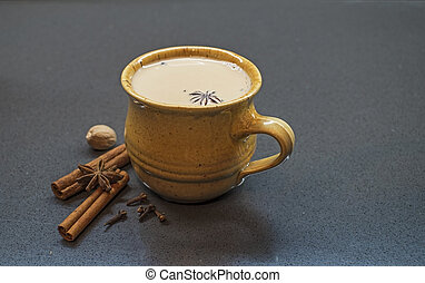 Indian tradition milk drink, masala chai tea with spices.