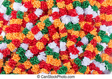Indian traditional culture stuff from colourful fabrics white red green orange for holy religious ritual. Useful for background.