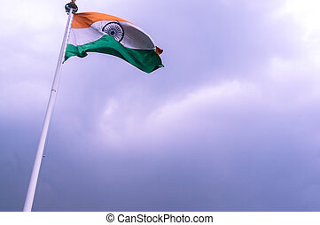 Indian tricolor fluttering in the wind against a cloudy sky...