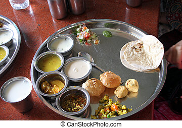 Indian vegetarian lunch served very hot and is too tempting
