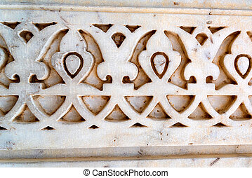 Indian wall pattern carved in stone