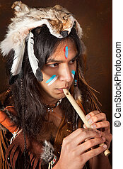 Indian with flute - Portrait of an Indian in traditional...