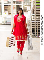 indian woman carrying shopping bags in mall