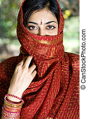 Closeup portrait of a beautiful indian woman wearing a traditional embroidered sari